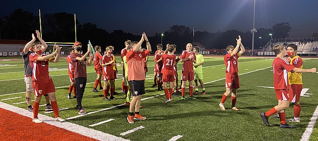 Tonganoxie High players clap toward the Bonner Springs bench after Thursday's game at Beatty Field. THS won, 2-0, against BSHS.