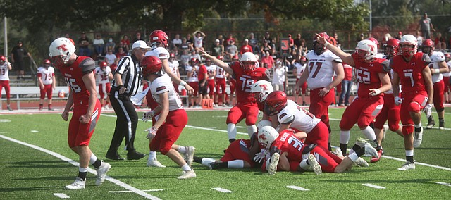 Tonganoxie High football players react to a fumble recovery early in Saturday's game against Southern Boone at Beatty Field. The Chieftains defeated the Eagles, 52-13, and improved to 5-1 on the season.