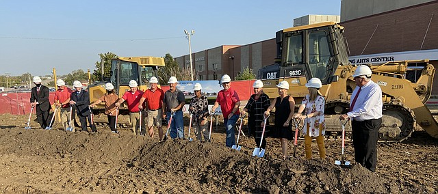 Tonganoxie school board members join with USD 464 and Tonganoxie High school administrators in turning over dirt during a groundbreaking ceremony for the new THS Academic Center on Wednesday, Oct. 7, on the THS campus.