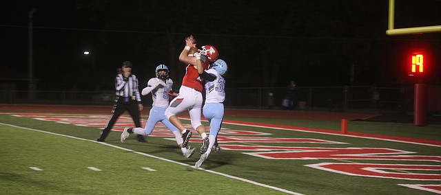 Tonganoxie High senior Dallas Bond ahuls in a catch Friday at Beatty Field. Bond scored three first-half stouchdowns on receptions from senior guarterback Blake Poje, helping THS to a 35-0 victory against Shawnee Mission East.