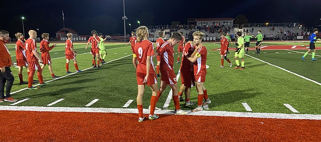 Tonganoxie High soccer players gather after the Nov. 3 state quarterfinal match against Bishop Miege. The Stags won the game, 3-1, before eventually wining the Class 4-3-2-1A title for yet another year. THS finished the season 11-5.
