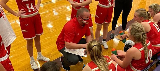 Tonganoxie High girls basketball coach Mitch Loomis talks to his team Friday at Louisburg. The Chiefatins fell, 59-47, in their season opener.