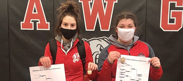 Tonganoxie High's Taylor Lux and Holly Colvert win gold Saturday at a Division II regional in Rossville.