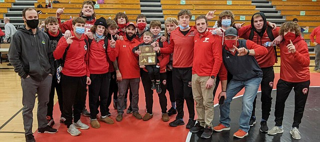 Tonganoxie High boys wrestling celebrates a regional championship early Saturday in Meriden. THS won the team title at Jeff West and now prepares for substate this Saturday at Chanute.