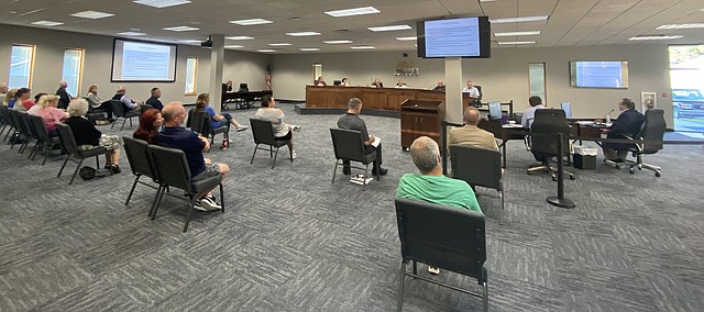 Area residents look on during Monday's Tonganoxie City Council meeting. The council approved an initial agreement with Hill's Pet Nutrition, Inc., to build a 300,000 square-foot manufacturing site for wet pet food at Tonganoxie Business Park.
