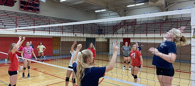Tonganoxie High volleyball players practice Monday, Aug. 30, 2021, at the THS gymnasium.