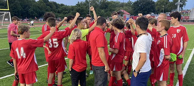 Tonganoxie High boys soccer coach Michael Barnes chats with his players after the team's 6-0 victory against Maur Hill Mount Academy on Thursday, Sept. 1, 2021, at Beatty Field.