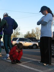 Adrain Grandchamp, 7,  huddles while his mother Leann watches at sixth annual Awesome Autumn 5K run sponsored by the Lansing Lions Club on Saturday Nov. 6.