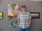 Eric Hoins in front of his two works 1940s What's the Rules in the New Dimensions, which won first place, and One Modern Age at the Holiday Juried Art Show reception on Sunday November 21 at Carnegie Art Center.