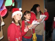 Lansing Brownies passed out fliers to guests at the 18th annual Lansing Mayor's Christmas Tree lighting ceremony on Sunday December 5, at Lansing Community Center.