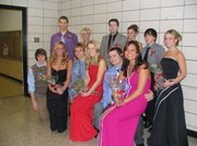 The Winter Royalty court before the coronation at Lansing Intermediate School on Friday Jan. 14. Front row, left to right, Andrew Phillips, Emily Goodlin, Chris Nelson, Jessica Haver, Chris Bristow and Kendra Sickinger. Back row, left to right, Matt Warner, Whitney Lozenski, Michael Rednicky, Alex Mosely, Nick Flynn and Kate Mock.