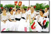 "Young girls cheer ""Vive Jalisco!"" before the start of the annual De Soto Cinco de Mayo parade. Saturday's event marked the second year for the celebration, which was attended by an estimated 1,000 people."