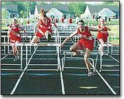 Tonganoxie hurdlers show their dominance during the finals at last week's Tonganoxie Invitational track meet. THS hurdlers pictured are, from left, Kelly Breuer, Jennifer Reischman, Aimee Eisman and Britney Jerome.