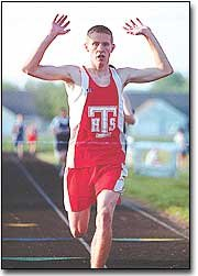 Kyle Norris crosses the finish line in first place at the Tonganoxie Invitational May 1. He took home a gold medal in the 800- and the 1.600-meters.