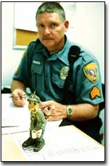 John Putthoff keeps this carving of a policeman on his desk.