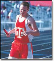 Jacob Hoffhines crosses the finish line, winning the 4x800-meter relay at Thursday's Kaw Valley League meet in Tonganoxie. The relay team should do well at this weeks Class 4A Regional meet in Tonganoxie, THS Coach Phil Williams said.