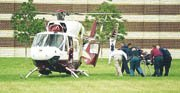 Emergency medical personnel rush Baldwin High School junior Anthony McClintock to the LifeStar helicopter Thursday after the incident that injured him in shop class.