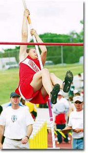 Erin O'Brien strains to clear eight feet at last weekend's Class 4A State Track Meet in Wichita.
