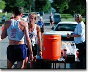 Matt Brisch, left, 33, and Steve Riley, 47, right, stop for a drink after finishing first and second, respectively, at the 10K Friends of the Library run at Tonganoxie Days. Fifty-nine runners participated in the event.