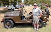 Dave Christenberry has collected and restored military vehicles for 15 years. His favorite collectibles are jeeps. He will drive this 1953 model Saturday in the De Soto Days Festival Parade with fellow military collectors. The vintage vehicles will later be on display at car show in Miller Park.