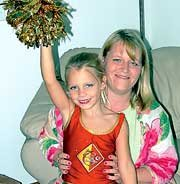 Rachel Parish is one of 152 Kansas City metropolitan area girls in the Chiefs junior cheerleader program. Her mother, Kim, said the program also included lessons in poise and manners.