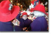 Pat Lebrecht, center, adjusts her hat as she waits with Roberta Schmitz (left) and Barbara Henre along with other members of the Red Hat Society to be seated for lunch last week at the Cracker Barrel.