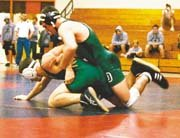De Soto sophomore Neil Erisman defeats Basehor-Linwood's Will Peterson at the 4A regional wrestling tournament at Hiawatha last Friday. Erisman and four teammates will be back in action Friday at the state tournament in Wichita.