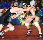 Neil Erisman fends off a charge by Pratt's Lucas Kramer in the state 4A wrestling meet Saturday in Wichita. The De Soto sophomore won the match, claiming third place in the competition. For the second year in a row, Erisman suffered his only defeat in state of the season with an overtime loss in the state meet.