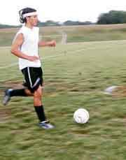 Wildcat captain Lance Williams keeps an eye on the ball during a conditioning drill last week. The DHS soccer team opens Friday with a home game against Perry Lecompton.