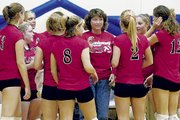 Lansing volleyball coach Julie Slater instructs her players during a timeout earlier this season at the Perry-Lecompton triangular. Slater is one of the winningest coaches in Kansas high school volleyball history.