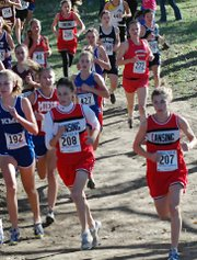 Rachel Pride, left, and Bianca Manago fight for position in the pack during the Class 5A cross country state meet Saturday at Rim Rock Farm in Lawrence. Erin Eustice can be seen about 10 yards back.