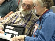 Richard Moppin discusses the finer details of the annexation petition with his wife Mary at the hearing.
