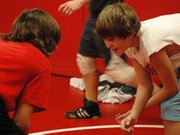 Lansing High freshmen wrestlers Chance Thackston, right, and Nick Flynn practice their technique during the first day of practice Monday at LHS.
