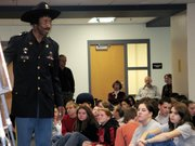 Lansing Middle school eighth-graders and IDEA students received a lesson in history Monday when members of the 9th and 10th Horse Cavalry Association - the Buffalo Soldiers - visited the school to talk about the all-black Army regiments. Four Buffalo Soldiers from the Greater Kansas City/Leavenworth chapter of the association, including chapter president James Madison, above, participated in the program.