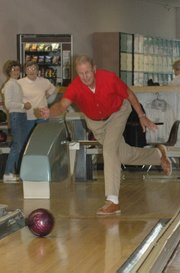 Lansing resident Marv McCurdy fires a strike on Friday afternoon at Skyway Lanes during senior league play. McCurdy and his wife, Dolores, have bowled at Skyway Lanes for 25 years.