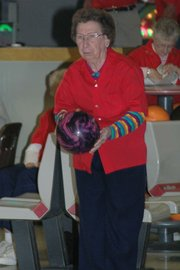 Lansing resident Margaret Swift prepares for her next roll on Friday afternoon at Skyway Lanes. Swift bowls every week during seniors league play.