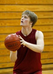Junior David Kern eyes a free throw during practice. Kern is one of two returning starters for the Lions.