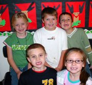 These second-graders in Denise Shelley's class at Lansing ElementarySchool sport smiles missing two front teeth. The students are, top row from left, Sydney Chiles, Trevor Young, and Aaron Hite, and bottom row from left, William Gering and Alyssa Acevedo.