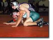 De Soto's Brandon Hurt works to escape the grasp of Baldwin wrestler Kevin Callahan. The two met Saturday at the Eudora Invitational, where Hurt compiled a 3-3 record and finished seventh in the 119-pound weight class.