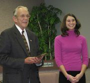 Lansing Mayor Kenneth Bernard recognized two area students for their volunteer service during Thursday's meeting of the Lansing City Council. Here, Bernard congratulates Tiffany Zimmerman.