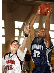 LHS junior Ryan Robbins battles a Mill Valley player for a rebound.