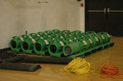 Blowers helped dry the gym floor after the flood.