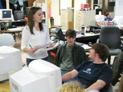 Jessica Riese, Steve Thomas and Chris Maxell discuss ideas for their next edition of LTV in Dan Wessel's class