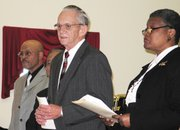 Mayor Kenneth Bernard, center, flanked by the Rev. B.J. Landrum and the Rev. Betty Hannah-Witherspoon, spoke at Sunday's tribute to Martin Luther King Jr. at Bethel AME Church in Leavenworth.