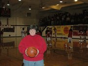 Former Lansing High girls' basketball coach Carol Caplinger catches a game at the Lansing Intermediate School gym where she coached the LHS girls during the 1987-88 season, the final season high school hoops was played in the old gym.