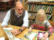 Paul Dorsey reads with Danish student Alma Wammen.