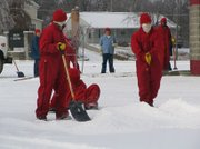 Inmates from the Lansing Correctional Facility work general upkeep around the county: shoveling snow, mowing grass and maintaining byways.