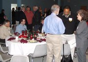 Local business owners mingle after the city's Salad and Solutions luncheon.