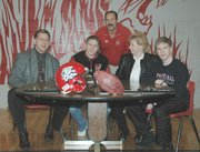 Lansing High senior John Tytla, second from left, signed a letter of intent to play college football at juco power Coffeyville Community College. Tytla was joined at the signing by his father, John, Sr., his mother, Kathy, his younger brother, Tom, and LHS football coach Bill Pekarek.