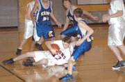 Cameron Trowbridge fights for a loose ball.